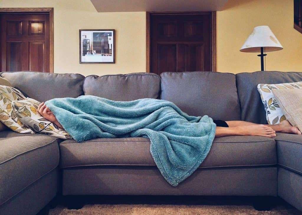 Person asleep on a couch