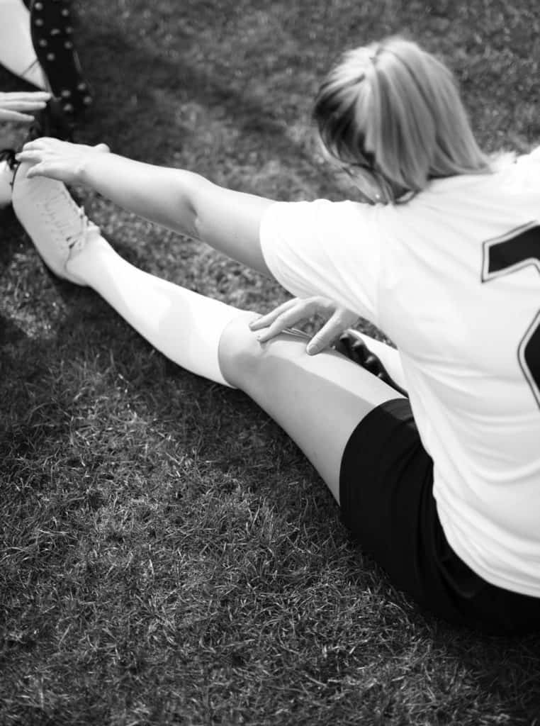 Soccer player stretching