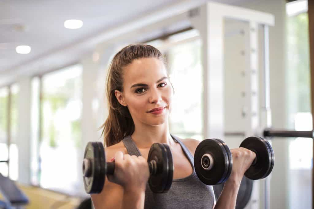 Woman holding dumbbells at the gym
